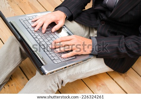 Businessman working with his computer - stock photo