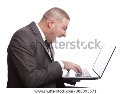 Businessman Working with Laptop - stock photo