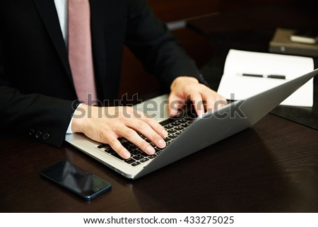 Businessman working with laptop computer - stock photo