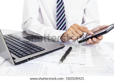 Businessman working with laptop computer and mobile phone