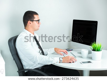 businessman working with laptop in office - stock photo