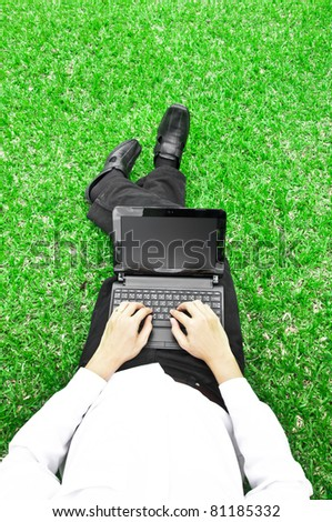 Businessman  Working with laptop in the field - stock photo