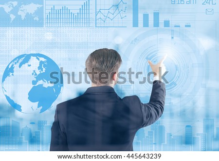 Businessman working with modern technology and digital layer effect - stock photo