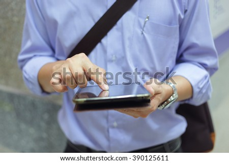 Businessman working with smartphone or taplet. Concept of modern
