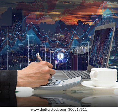 Businessman working with the laptop for earn the usd dollar money on Trading graph on the cityscape at night and world map background,Business financial concept - stock photo