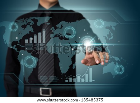 Businessman working with touch screen technology - stock photo