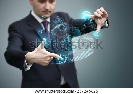 Businessman working with virtual holographic earth interface. Future technology as design concept.