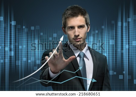 Businessman working with virtual technology touching the arrow on the chart - stock photo