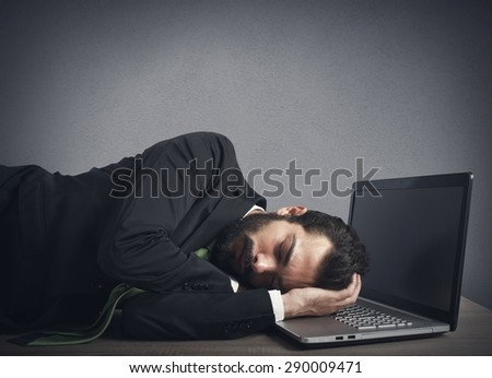 Businessman workload falls asleep tired on computer - stock photo