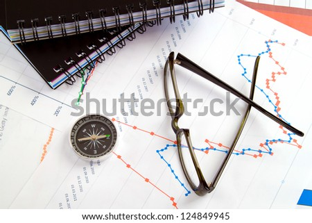 businessman workplace. Compass and glasses - stock photo