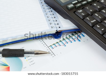 businessman workplace with money, coins, pen and calculator