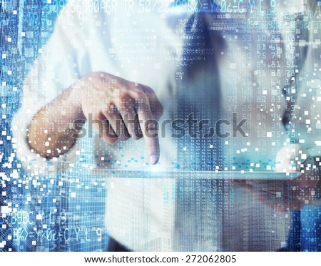 Businessman works and designs with futuristic technology - stock photo