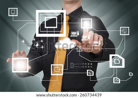 Businessman works on huge tech screen - stock photo