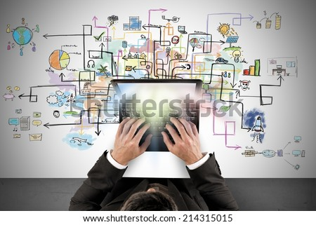 Businessman works with a laptop about new creative project - stock photo