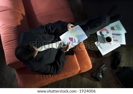 Businessman works with colored graphs. - stock photo