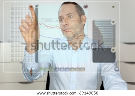 Businessman works with futureistic computer display - stock photo