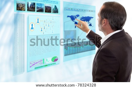 Businessman works with futuristic Display - stock photo