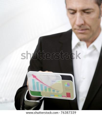 Businessman works with futuristic PDA - stock photo
