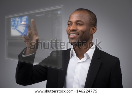 Businessman works with futuristic touch panel - stock photo