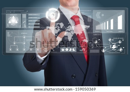 Businessman works with huge tech screen plenty of media icons - stock photo