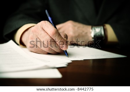 businessman works with papers