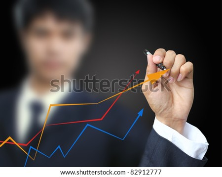 Businessman write graph