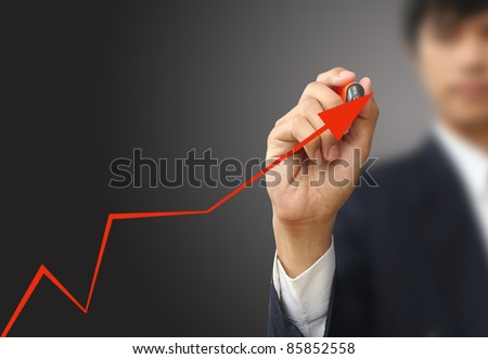 Businessman write line graph - stock photo