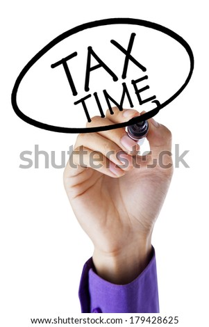 Businessman write tax time for paying tax on transparent whiteboard - stock photo