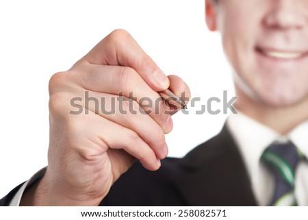 Businessman writes a pen isolated - stock photo