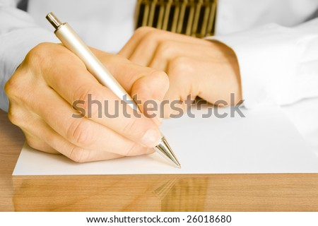 Businessman writes a pen on an empty paper