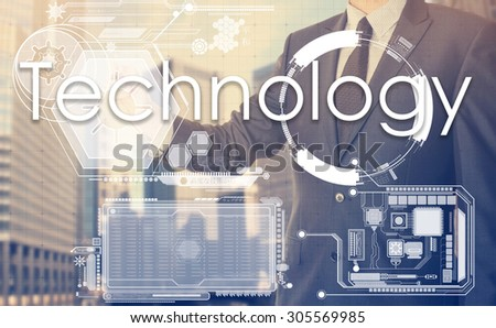 businessman writes on board text: Technology - with sunset over the city in the background, the visible sun's rays in a picture are symbolizing the positive attitude - stock photo