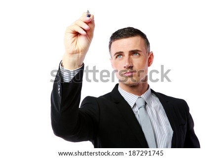 Businessman writes with pen at copyspace over white background - stock photo