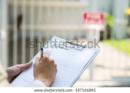 Businessman writing a contract - stock photo