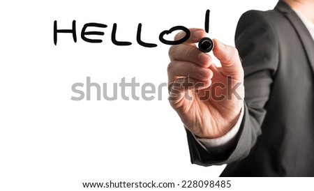 Businessman writing a greeting - Hello - on a virtual interface with a black marker pen over a white background with copyspace for your text, close up of his hand. - stock photo