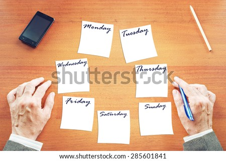 Businessman writing a plan to the week - stock photo