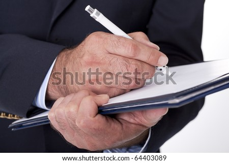 businessman writing and doing paperwork - stock photo