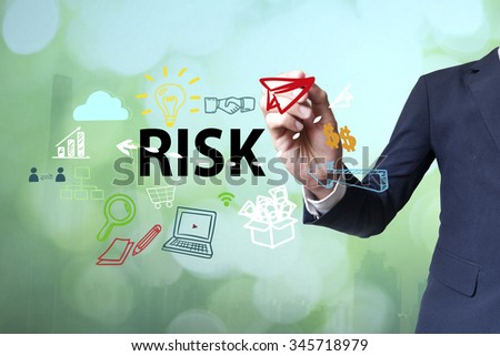 Businessman writing and drawing risk concept on blurred abstract background , business concept  - stock photo