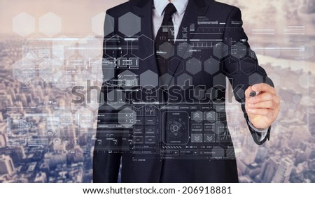 businessman writing and drawing some sketches with modern city in background - stock photo