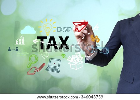 Businessman writing and drawing tax concept on blurred abstract background , business concept  - stock photo