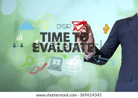 Businessman writing and drawing TIME TO EVALUATE concept on blurred abstract background , business concept , business idea - stock photo
