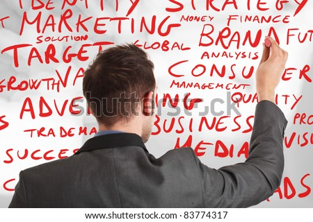 Businessman writing business concepts - stock photo