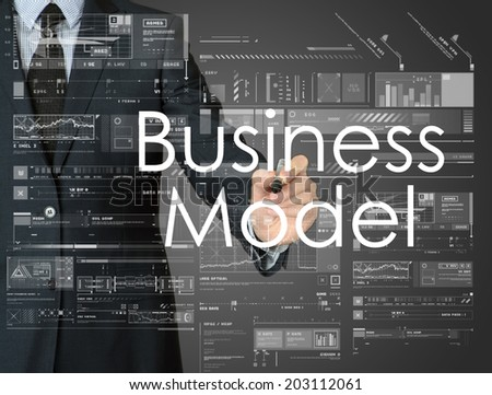 businessman writing business model and drawing graphs and diagrams - stock photo