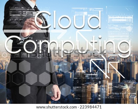 businessman writing Cloud Computing on transparent board with city in background - stock photo