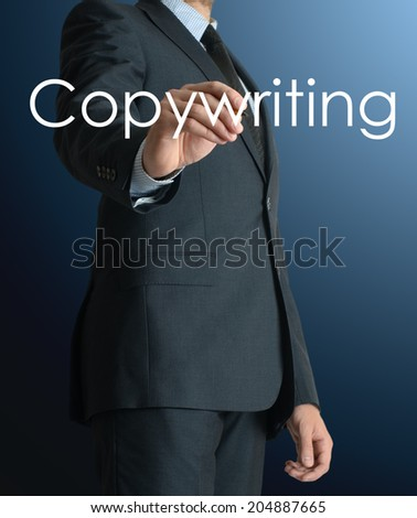businessman writing Copywriting and drawing some sketches  - stock photo