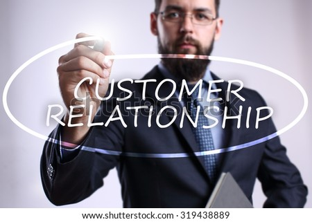 """Businessman writing """"Customer relationship"""" with marker on transparent board. Business, internet, technology concept. - stock photo"""