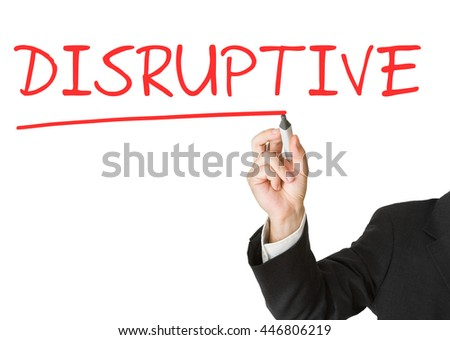 "Businessman writing ""Disruptive"" on whiteboard with marker"