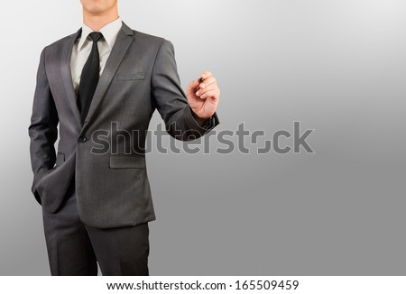 Businessman writing, drawing on blank space - stock photo