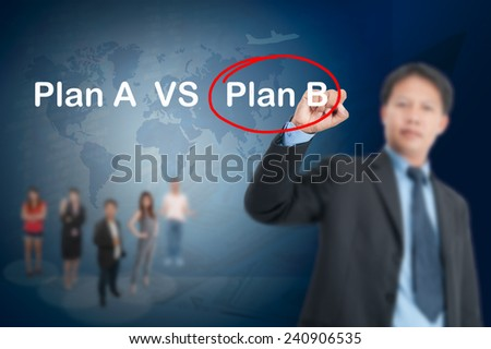 Businessman writing, drawing plan A ana plan B on the screen.has teamwork,map,plane and map - stock photo