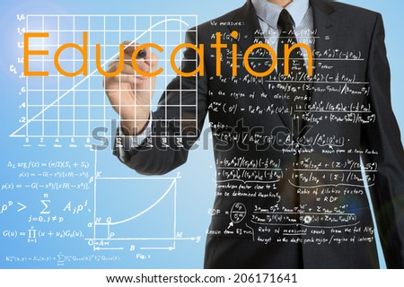 businessman writing Education and drawing graphs and diagrams  - stock photo