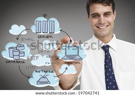 Businessman writing flowchart against grey vignette - stock photo